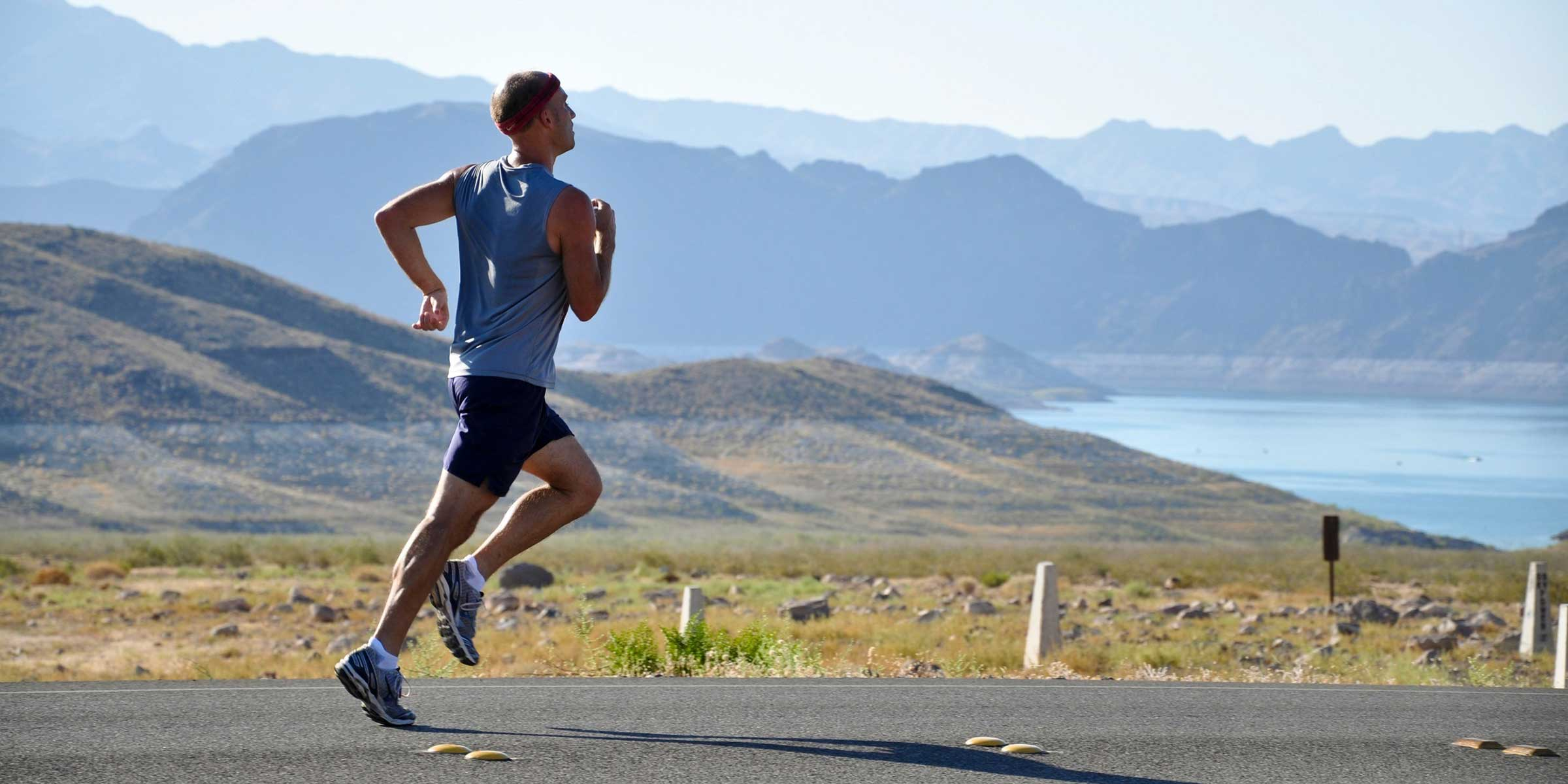 A runner heads out on the run, looking to finish his first triathlon on a sunny day in Southern BC.