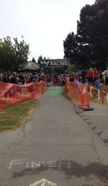 Final Finisher crossing the finish line at the 2014 Vic Youth Triathlon 2014