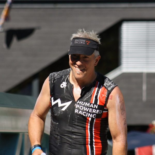 Brian on run at Ironman Whistler. Covered in Salt