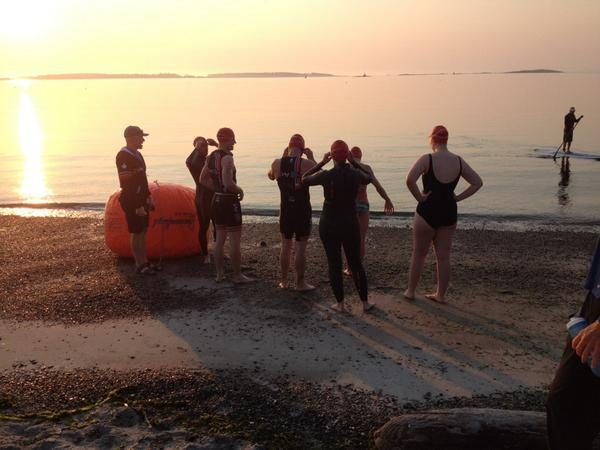 Athletes standing at waters edge for the first wave of the first ever Eliminator Triathlon
