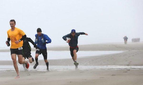 Adrian running along beach at Oregon 50km