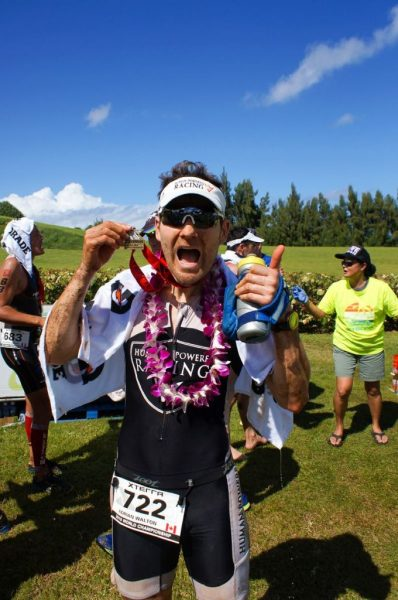 Adrian celebrates with his medal at the end of the XTERRA World Championship 2015