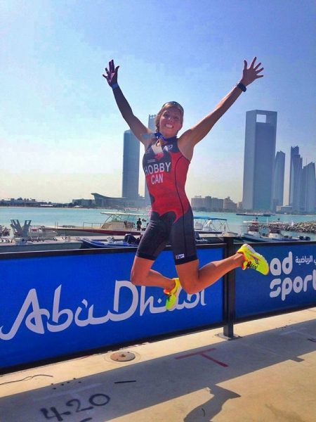 Kara Hobby jumping for joy at the Abu Dhabi ITU Triathlon Sprint race after finishing 15th overall