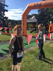 A Happy Finisher at the finish of the HPR Youth Triathlon West Shore