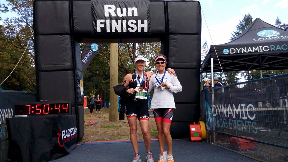 April Vesey and Sharon Craig showing off their medals at the finish line of the Cultus Lake Triathlon