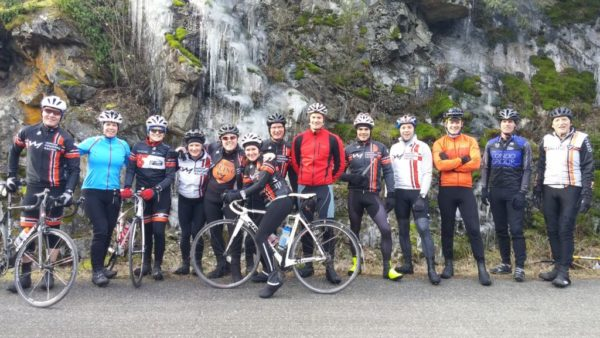 human powered racing athletes pose in front of ice while on their saturday ride at the observatory
