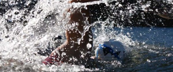 A Human Powered Racing swimmer in the water midstroke.