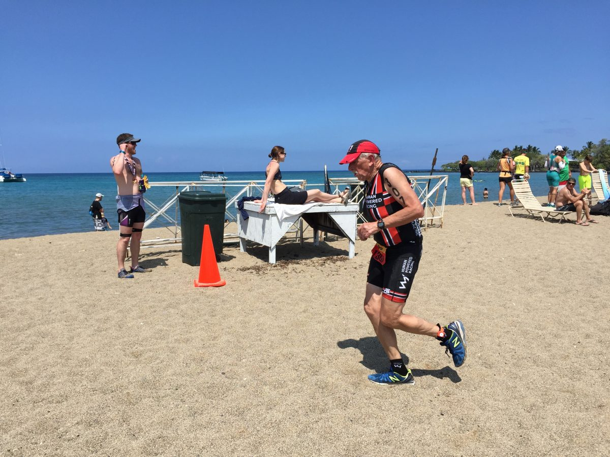 Justin Martin Running along A Bay on the Big Island of Hawaii during Lavaman Triathlon