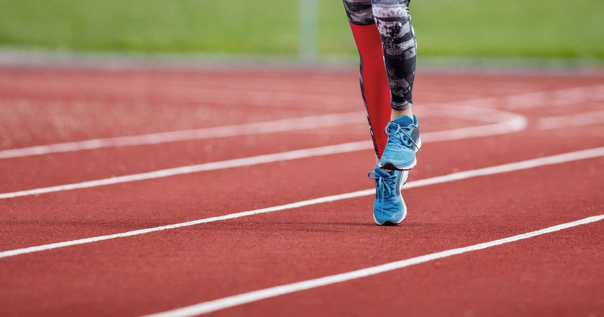 An athlete works on some technique on a track