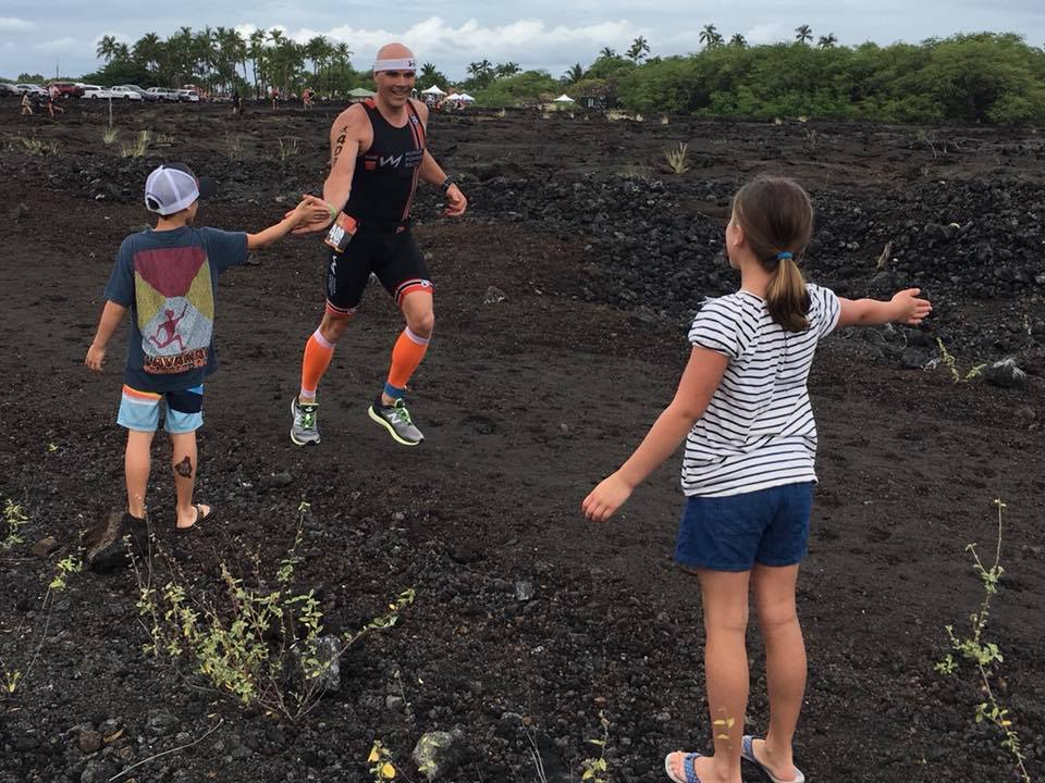 Jay Krieger High Fives his kids on the run course of Lavaman 2018