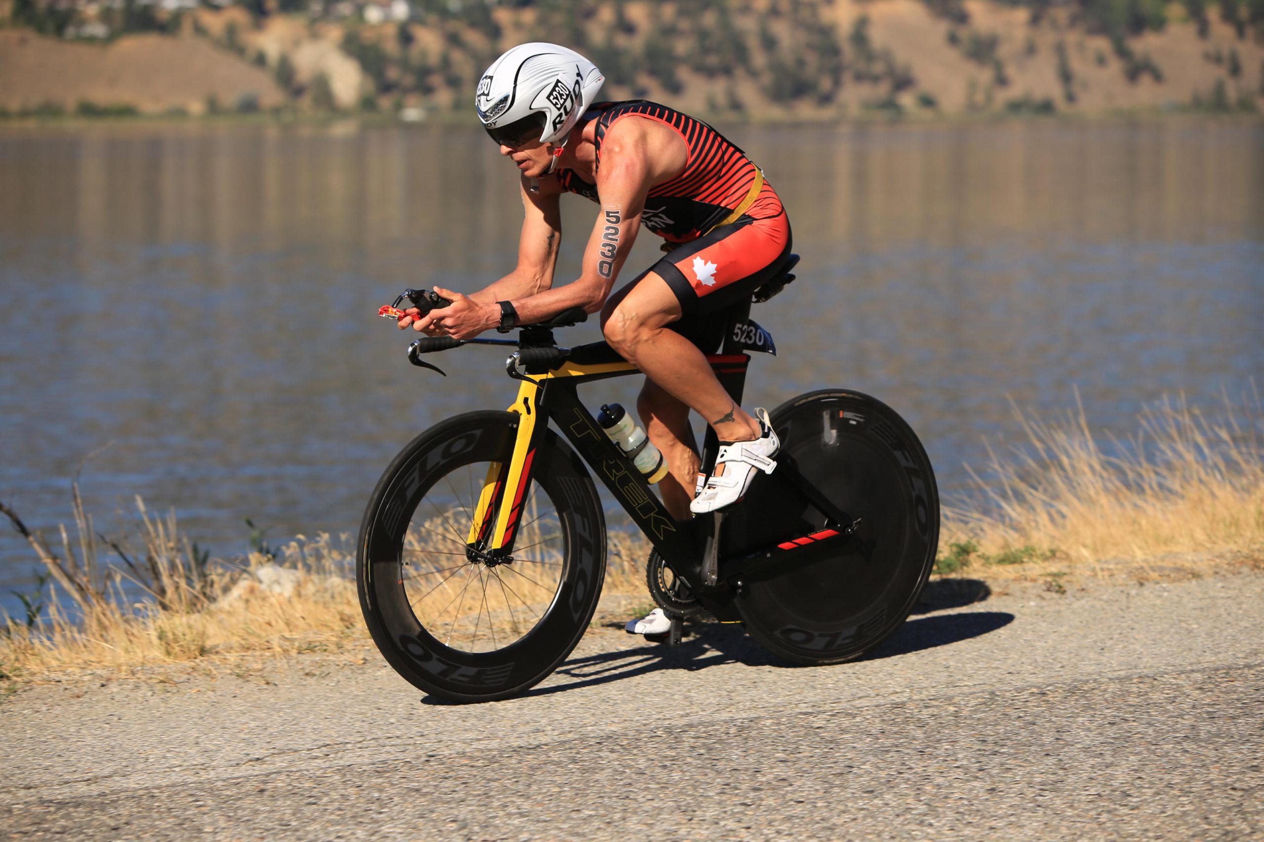 Mike Neill Riding Bike at 2017 ITU World Long Distance Triathlon Championship in Victoria