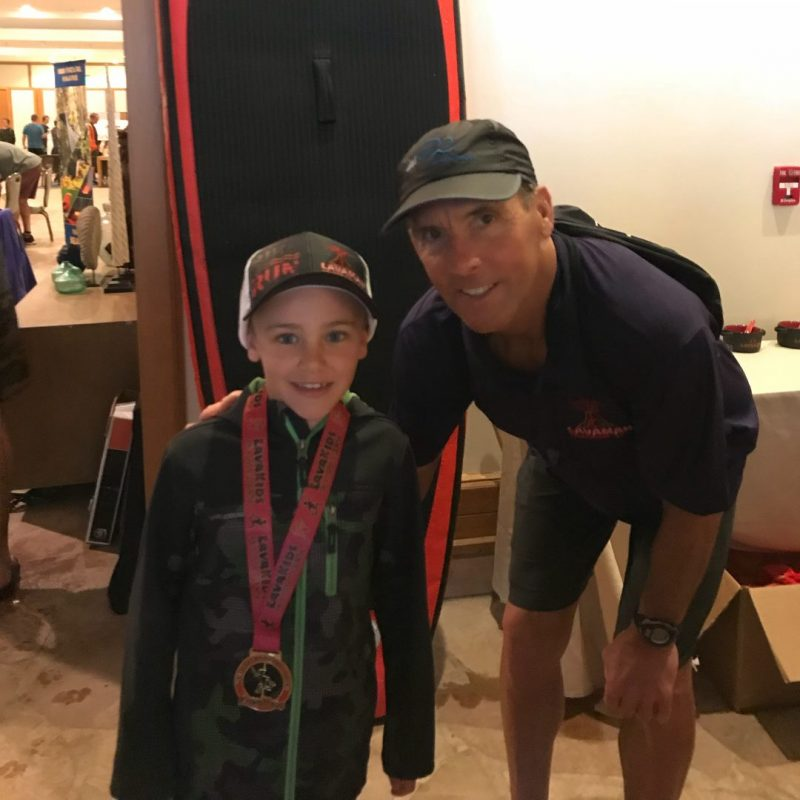 Grayson and Dave Scott at the awards of the Lavaman Kids Triathlon