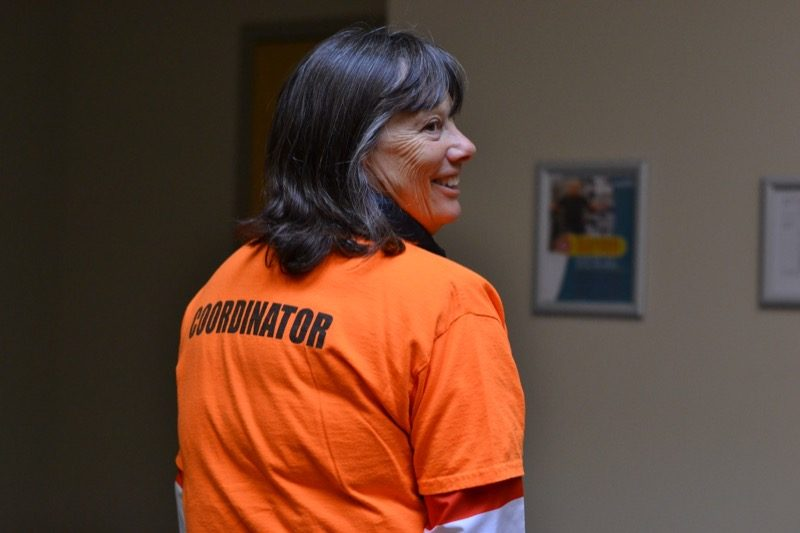 Melanie, the Race Coordinator shows us her title on the back of her shirt.
