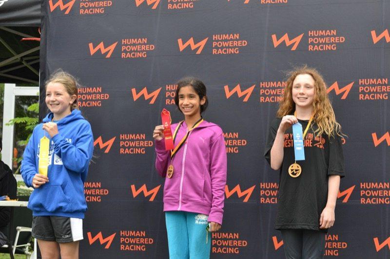 Girls 10 to 11 podium.