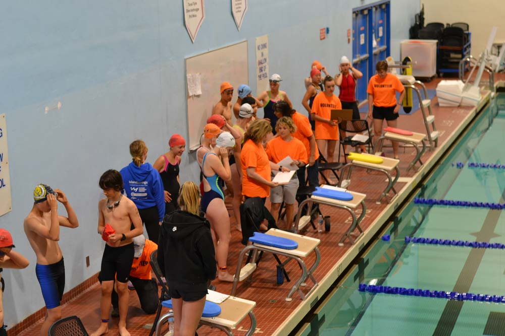 Swimmers and volunteers on deck at the McKinnon gym pool.