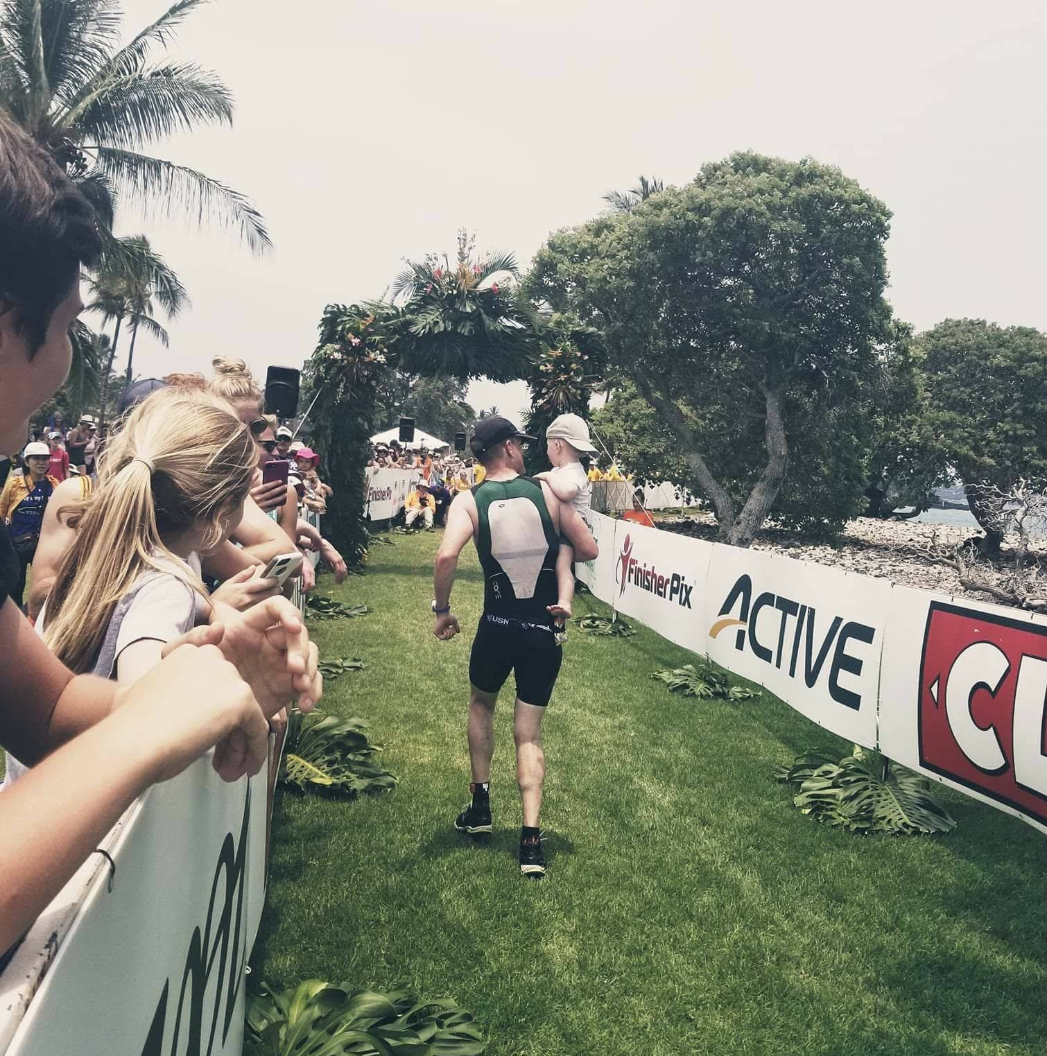 Richard and Lachlan crossing the finish like at Hawaii 70.3