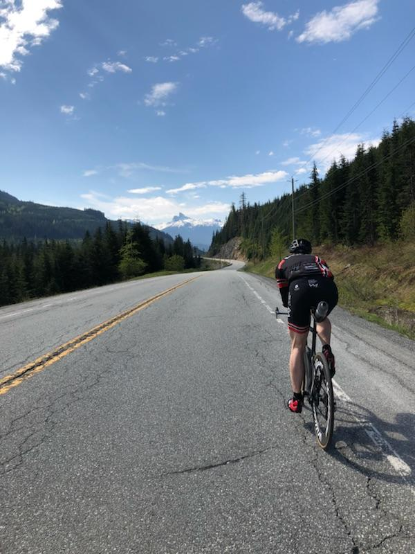 Ivor John riding on the Ironman Canada Bike Course in Whistler, B.C.