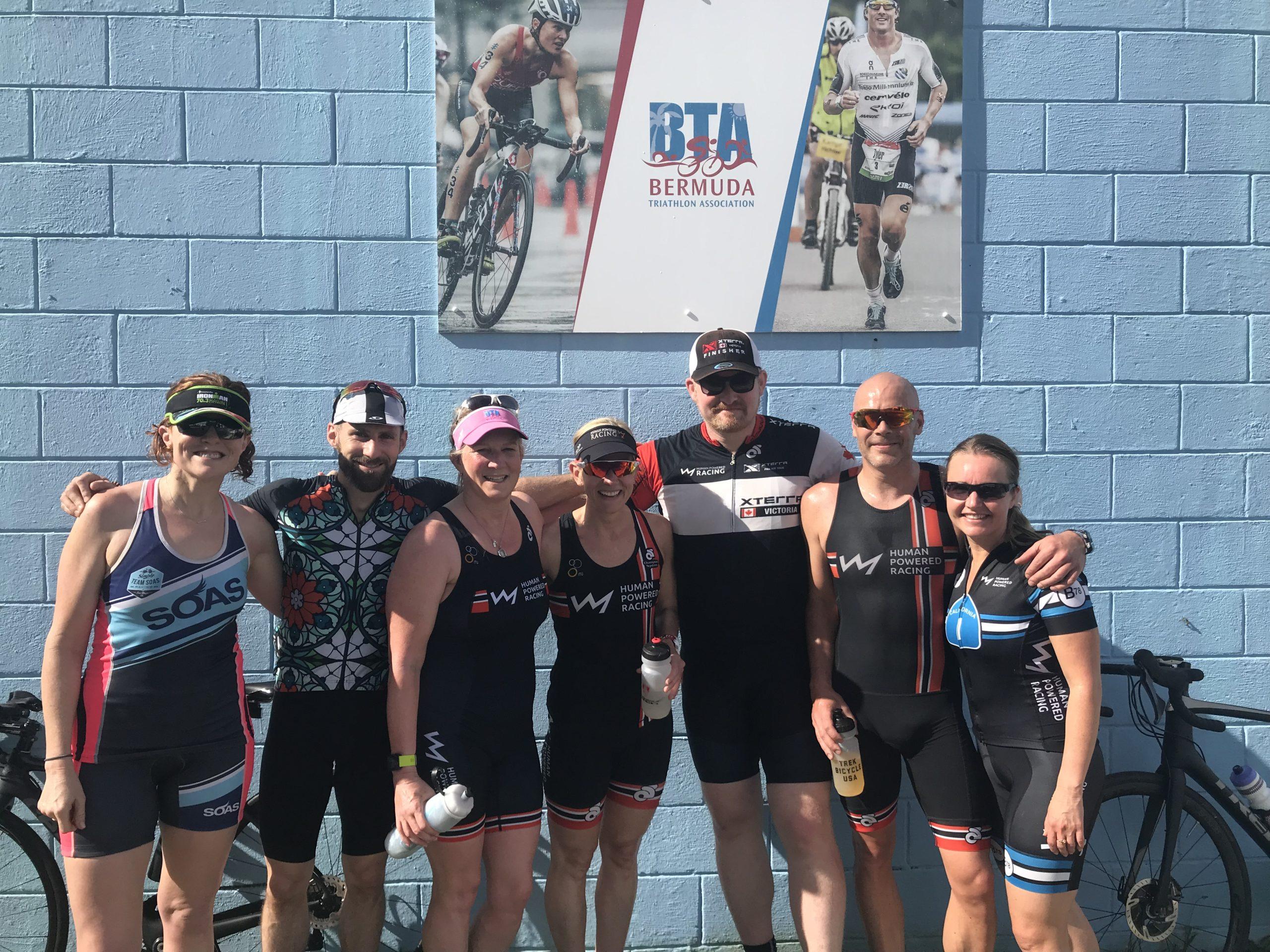 Human Powered Racing athletes pre race in front of Bermuda Triathlon Association Training Hut