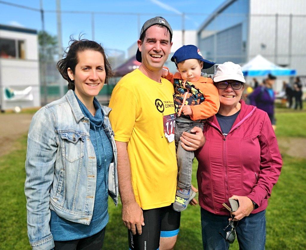 family at the finish of triathlon