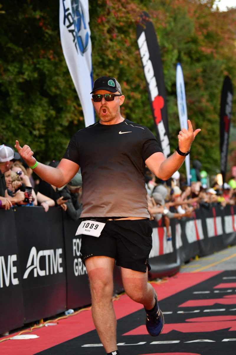 Mark Hopkins coming across the finish line at Ironman Canada in Whistler