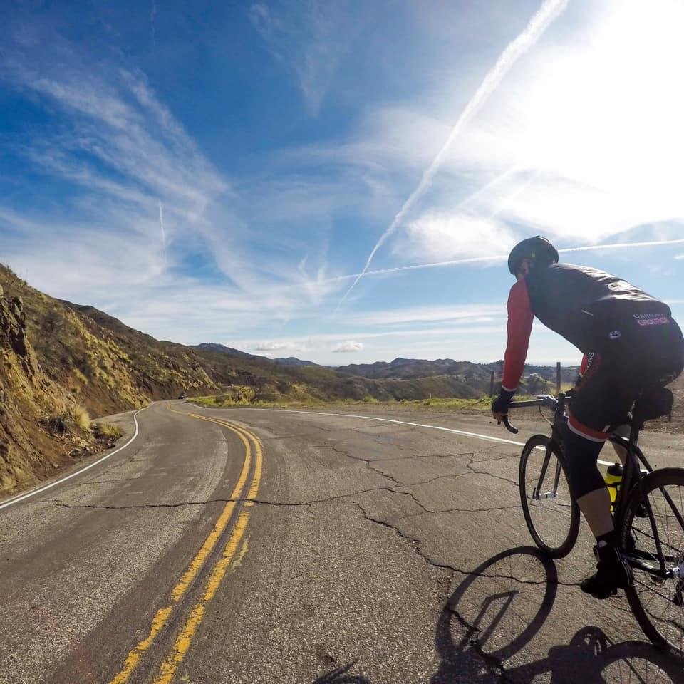 Derek Hopkins riding up Decker Road on Day 1 of Vertical Camp Triathlon Camp