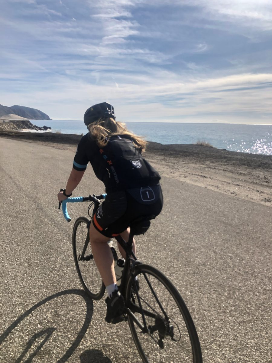 Catherine Holder riding bicycle along the Pacific Coast Highway at Human Powered Racing Vertical Camp 2020