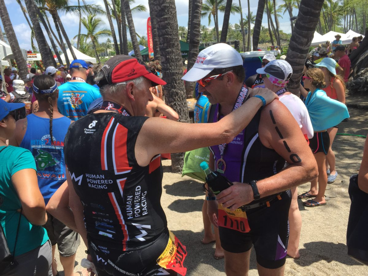 Justin Martin Congratulating Ed Walsh at the finish of Lavaman Triathlon