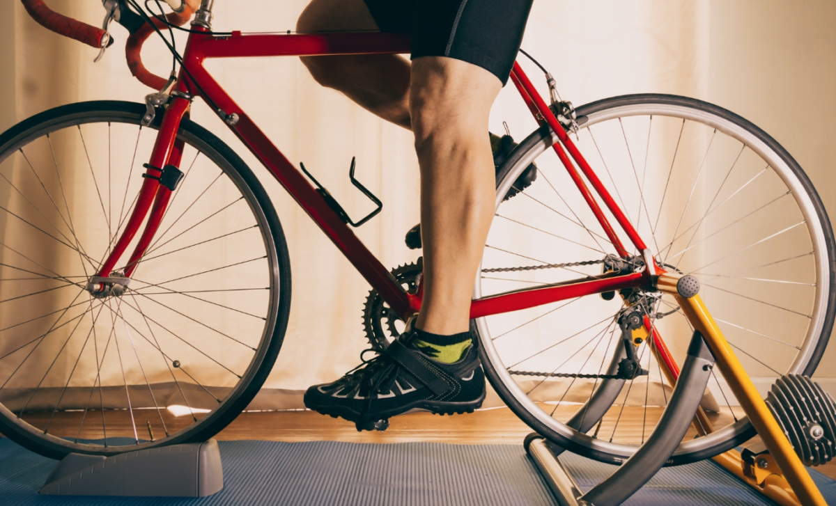 Legs of a cyclist on a bike mounted on a trainer