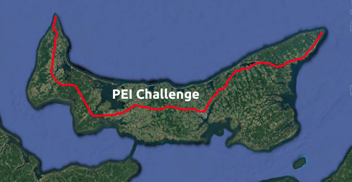 An image of Prince Edward Island with a cycling course marked with a red line.