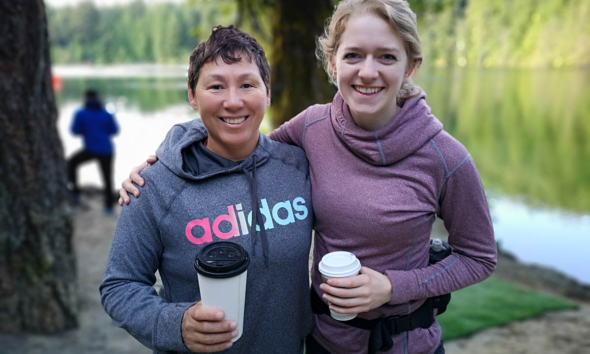 XTERRA Victoria 2019 - two racers wait with their coffees by a picture perfect lake.