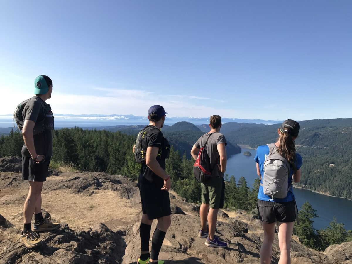 Runners looking back at Olympic Mountains from Jocelyn Hill