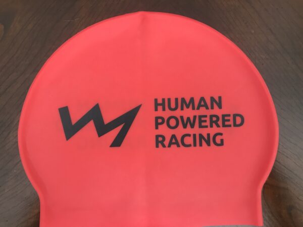 red swim cap with HPR logo