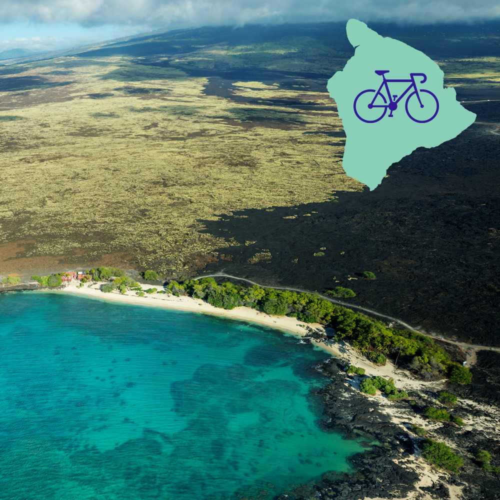 Big Island of Hawaii as seen from the air, with cobalt blue waters.