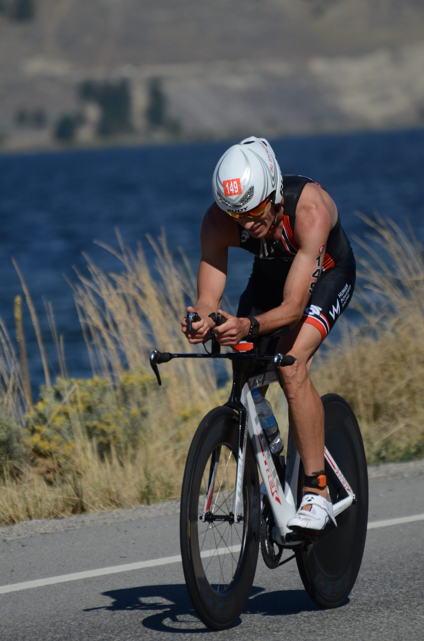 Mike Riding Time Trial Bike along Skaha Lake at Challenge Penticton