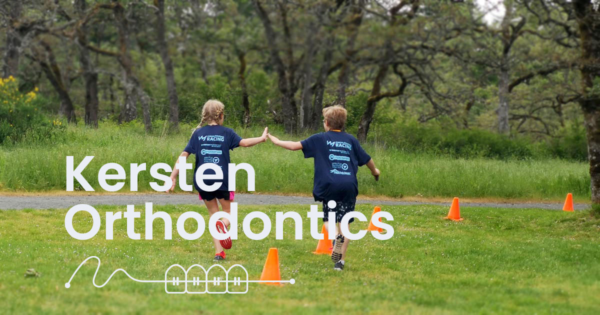 Kersten Orthodontics logo over top of two young triathletes high fiving.