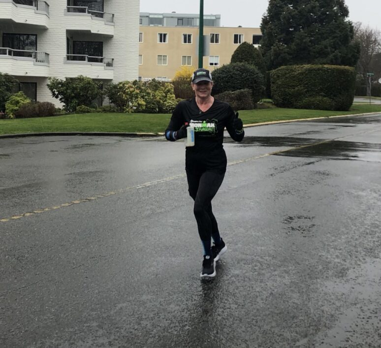 April Vesey running along Beach Drive past the Oak Bay Marina on her way to a sub 2 hour half marathon